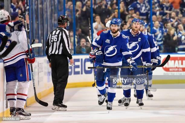 Tampa Bay Lightning right wing Nikita Kucherov and Tampa Bay Lightning center Steven Stamkos skate to the bench following Kucherov's goal during the...