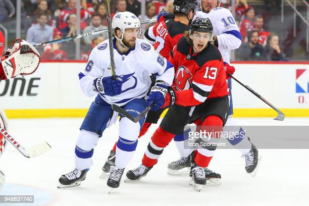Tampa Bay Lightning right wing Nikita Kucherov battles New Jersey Devils center Nico Hischier during the third period of the First Round Stanley Cup...
