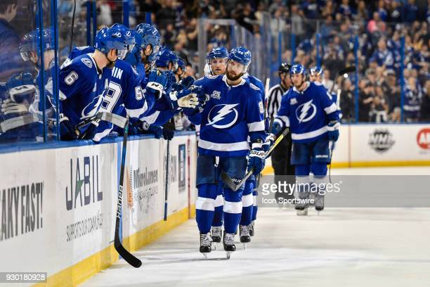 Tampa Bay Lightning right wing Nikita Kucherov celebrates his goal with his bench during the third period of an NHL game between the Montreal...