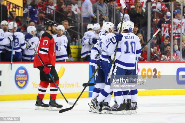 Tampa Bay Lightning right wing Nikita Kucherov celebrates with teammates after he shoots the puck into the empty net during the third period of the...