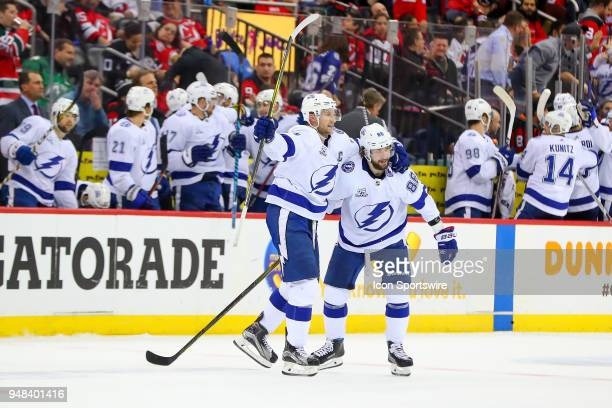 Tampa Bay Lightning right wing Nikita Kucherov celebrates with teammate Tampa Bay Lightning center Steven Stamkos after he scores an empty net goal...