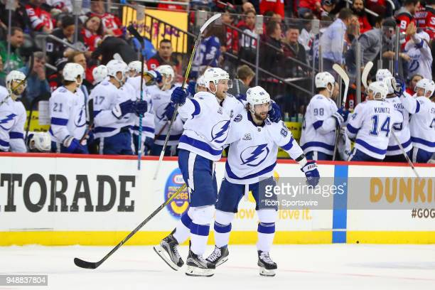 Tampa Bay Lightning right wing Nikita Kucherov celebrates with teammate Tampa Bay Lightning center Steven Stamkos after he shoots the puck into the...