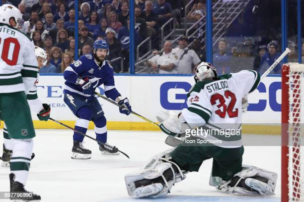 Tampa Bay Lightning right wing Nikita Kucherov has his shot blocked by Minnesota Wild goalie Alex Stalock in the second period of the NHL game...