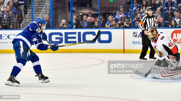 Tampa Bay Lightning right wing Nikita Kucherov has his stick break as he takes a shot during the shootout of an NHL game between the Ottawa Senators...