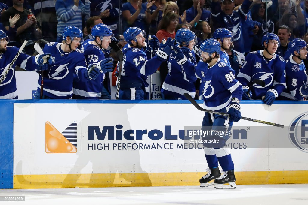 Tampa Bay Lightning right wing Nikita Kucherov (86) is congratulated by teammates on the Lightning bench after scoring a goal in the first period of the NHL game between the Vancouver Canucks and Tampa Bay Lightning on February 08, 2018 at Amalie Arena in Tampa, FL.