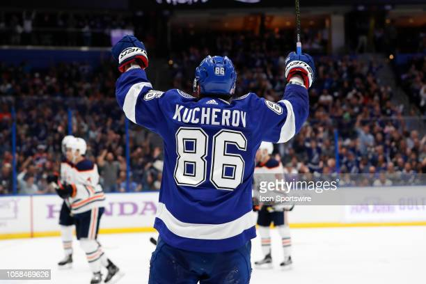 Tampa Bay Lightning right wing Nikita Kucherov raises his arms to celebrate a goal in the second period of the regular season NHL game between the...