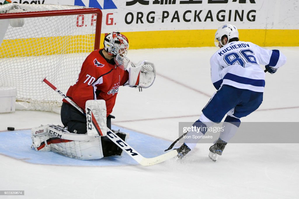 Tampa Bay Lightning right wing Nikita Kucherov (86) scores in the third period against Washington Capitals goaltender Braden Holtby (70) on February 20, 2018, at the Capital One Arena in Washington, D.C. The Tampa Bay Lightning defeated the Washington Capitals, 4-2.