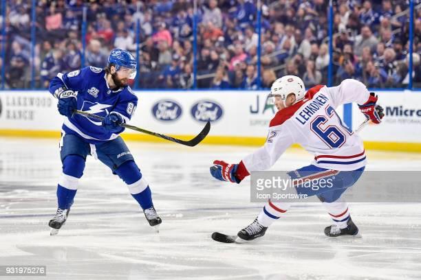 Tampa Bay Lightning right wing Nikita Kucherov shoots past Montreal Canadiens left wing Artturi Lehkonen during the second period of an NHL game...