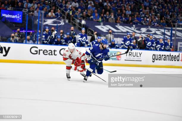 Tampa Bay Lightning right wing Nikita Kucherov skates away from the pressure by Carolina Hurricanes right wing Andrei Svechnikov during Game 4 of the...