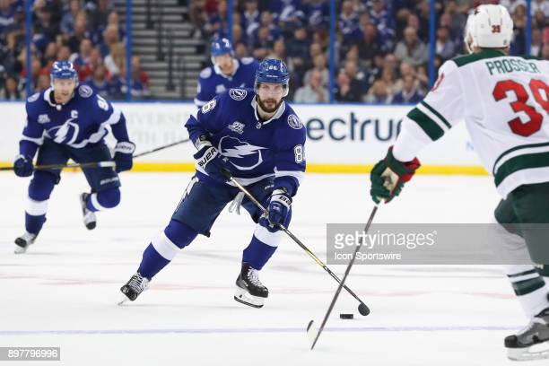 Tampa Bay Lightning right wing Nikita Kucherov skates the puck toward Minnesota Wild defenseman Nate Prosser in the second period of the NHL game...
