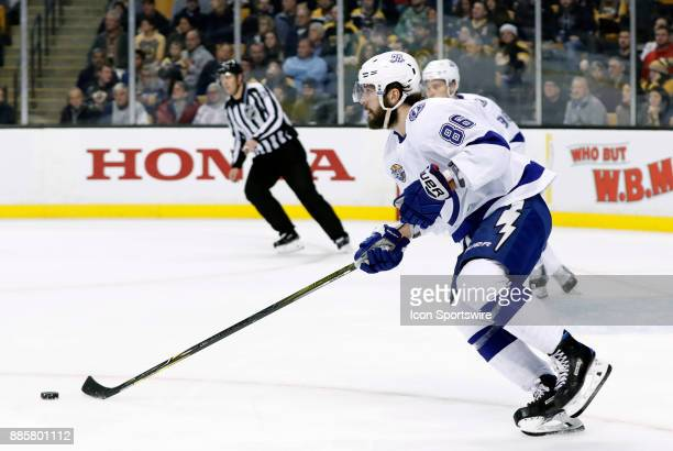 Tampa Bay Lightning right wing Nikita Kucherov skates up ice with the puck during a game between the Boston Bruins and the Tampa Bay Lightning on...