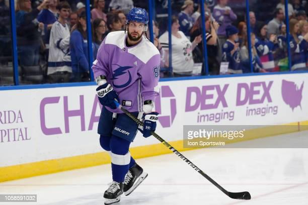 "Tampa Bay Lightning right wing Nikita Kucherov wears a ""Hockey Fights Cancer"" jersey before the regular season NHL game between the Edmonton Oilers..."