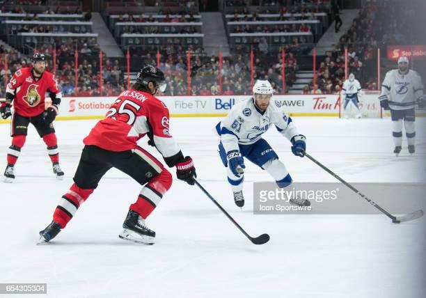 Tampa Bay Lightning Winger Gabriel Dumont stickhandles the puck against Ottawa Senators Defenceman Erik Karlsson during the NHL game between the...