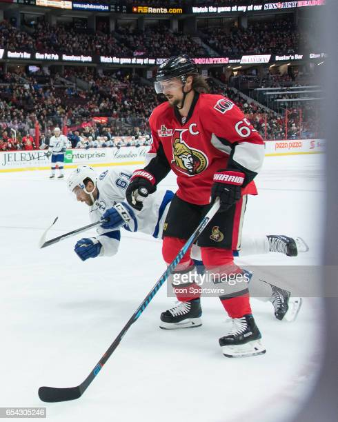 Tampa Bay Lightning Winger Gabriel Dumont trips over Ottawa Senators Defenceman Erik Karlsson during the NHL game between the Ottawa Senators and the...