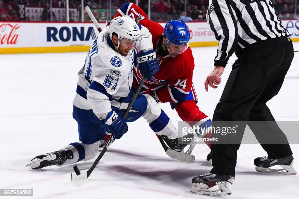 Tampa Bay Lightning Winger Gabriel Dumont wins face off against Montreal Canadiens Center Tomas Plekanec during the Tampa Bay Lightning versus the...