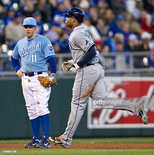 Tampa Bay Rays' Carl Crawford right rounds the bases in front of Kansas City Royals third baseman Josh Fields after Crawford hit a solo home run in...