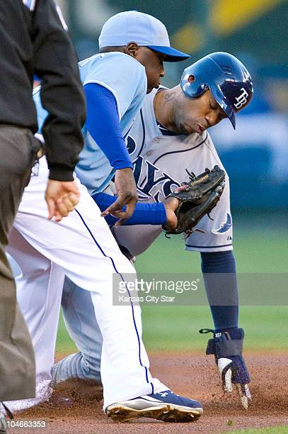 Tampa Bay Rays' Carl Crawford right steals second before the tag from Kansas City Royals shortstop Yuniesky Betancourt in the first inning at...