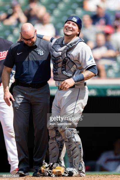 Tampa Bay Rays Catcher Jesus Sucre is attended to by a trainer after being shaken up after being hit by a foul tip during the ninth inning of the...