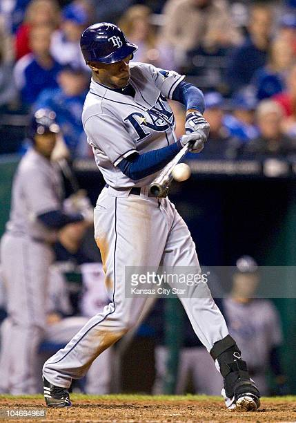 Tampa Bay Rays center fielder BJ Upton connects on a sacrifice fly to score Jason Bartlett from third base in the fifth inning at Kauffman Stadium in...