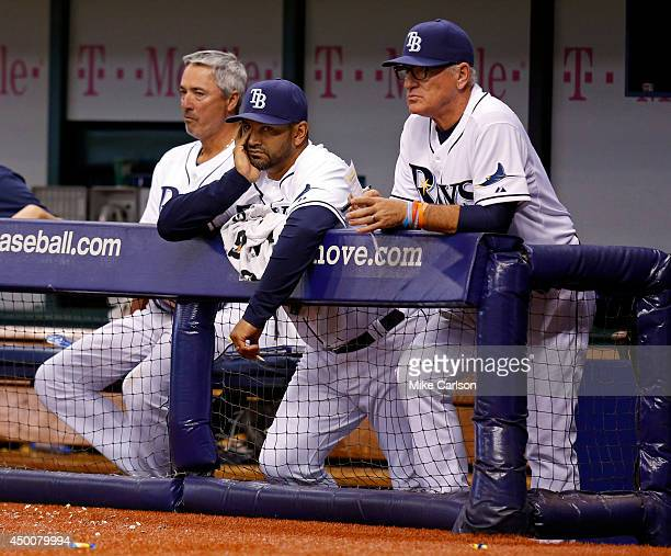 Tampa Bay Rays coaches Tom Foley Dave Martinez and manager Joe Maddon look on during a baseball game against the Miami Marlins at Tropicana Field on...