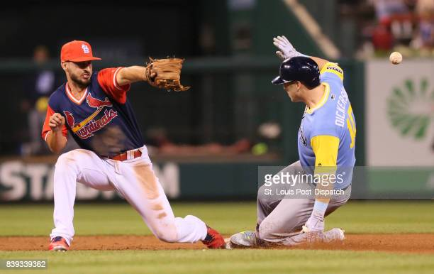 Tampa Bay Rays' Corey Dickerson is hit in the back by a throw from St Louis Cardinals right fielder Stephen Piscotty as he slides into second with a...