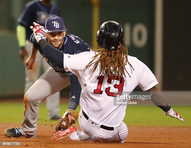 Tampa Bay Rays' Danny Espinosa tags out Boston Red Sox player Hanley Ramirez after he tried to stretch a single into a double during the fourth...