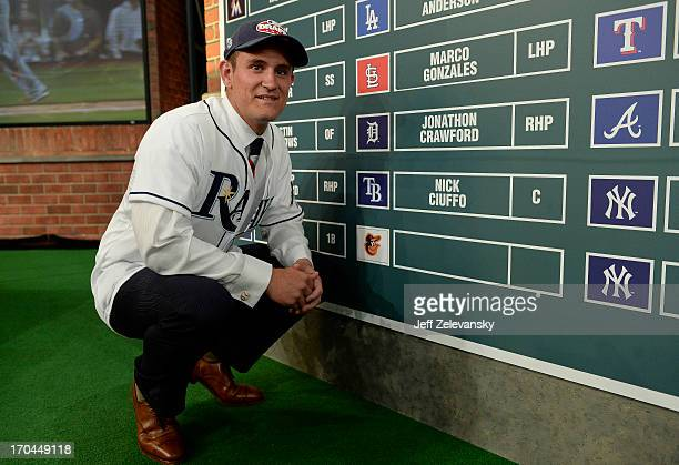 Tampa Bay Rays draftee Nick Ciuffo poses near the draft board at the 2013 MLB FirstYear Player Draft at the MLB Network on June 6 2013 in Secaucus...