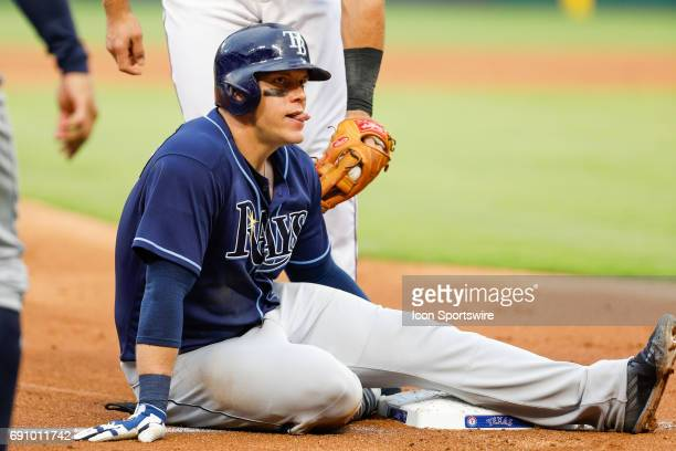 Tampa Bay Rays First base Logan Morrison reacts after turning an error into a triple during the MLB game between the Tampa Bay Rays and Texas Rangers...