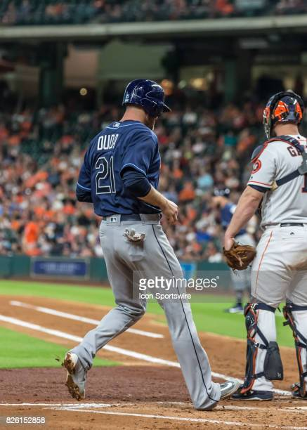 Tampa Bay Rays first baseman Lucas Duda taps home plate after scoring a run in the third inning of the MLB game between the Tampa Bay Rays and...