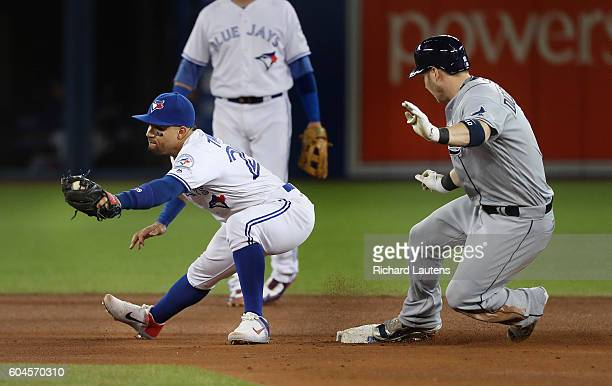 TORONTO ON SEPTEMBER 13 Tampa Bay Rays left fielder Corey Dickerson is safe on a double in the 5th as Toronto Blue Jays second baseman Devon Travis...