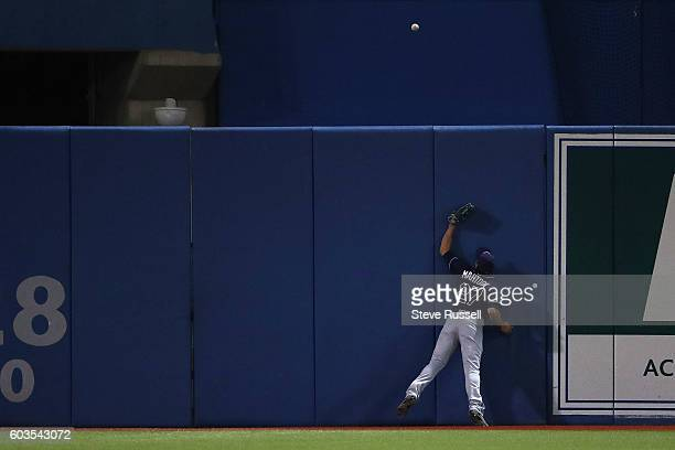 TORONTO ON SEPTEMBER 12 Tampa Bay Rays left fielder Mikie Mahtook cannot get to Toronto Blue Jays Jose Bautista two run homer in the sixth inning as...