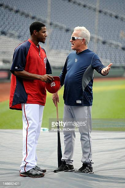 Tampa Bay Rays manager Joe Maddon talks with Edwin Jackson of the Washington Nationals before a game at Nationals Park on June 21 2012 in Washington...