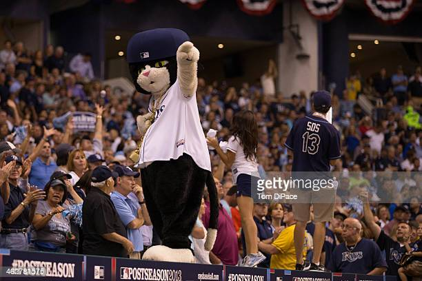 Tampa Bay Rays mascot DJ Kitty entertains the crowd in between innings during Game 3 of the American League Division Series against the Boston Red...