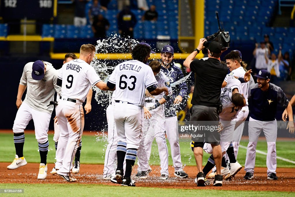 Tampa Bay Rays players celebrate after Matt Duffy #5 hits a walk-off single against the Toronto Blue Jays on June 13, 2018 at Tropicana Field in St Petersburg, Florida. The Rays won 1-0.