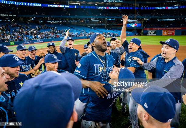 Tampa Bay Rays players celebrate clinching a wild card playoff spot after defeating the Toronto Blue Jays in their MLB game at the Rogers Centre on...