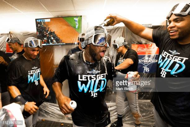 Tampa Bay Rays players celebrate with champagne for clinching a wild card spot after defeating the Toronto Blue Jays in their MLB game at the Rogers...
