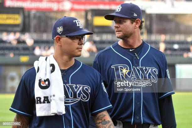 Tampa Bay Rays starting pitcher Anthony Banda with Tampa Bay pitching coach Kyle Snyder before a Major League Baseball game between the Tampa Bay...