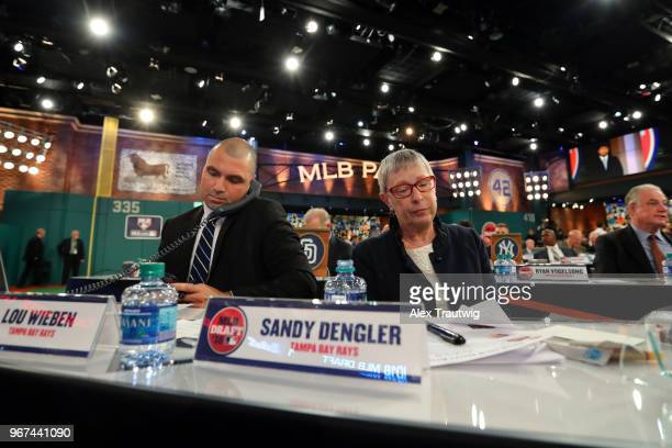 Tampa Bay Rays team reps Lou Wieben and Sandy Dengler look on during the 2018 Major League Baseball Draft at Studio 42 at the MLB Network on Monday,...