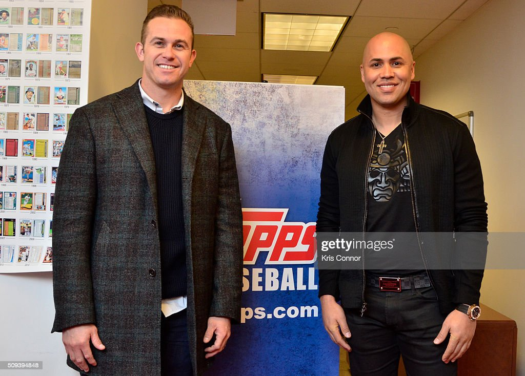 Tampa Bay Rays third baseman Evan Longoria and New York Yankees right fielder Carlos Beltran attend the 'Open Topps Baseball Series 1 Cards ' event at the Topps' offices on February 10, 2016 in New York City.