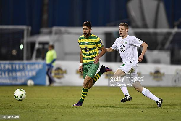 Tampa Bay Rowdies forward Jaime Siaj tries to beat Vfl Wolfsburg defender Paul Jaeckel to a through pass during the second half of a Florida Cup...