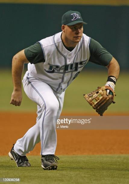 Tampa Bay third baseman Ty Wigginton comes in to field a bunt during Saturday night's action against Boston at Tropicana Field in St. Petersburg,...