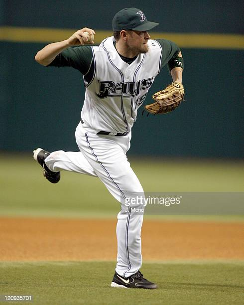Tampa Bay's Aubrey Huff makes a offbalance throw to get the out in Friday night's game against Atlanta at Tropicana Field in St Petersburg Florida on...