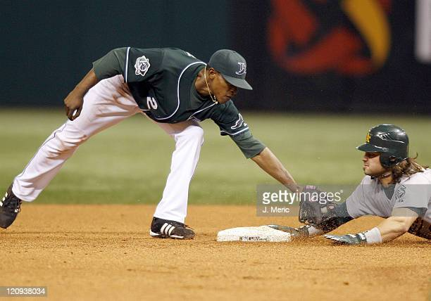 Tampa Bay's BJ Upton is late with the tag as Oakland's Nick Swisher slides safely into second during Friday night's game at Tropicana Field in St...