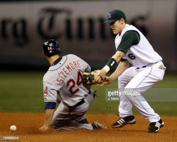 Tampa Bay's Brendan Harris tries to make the play at second but the throw is late and Cleveland's Grady Sizemore is safe at second at Tropicana Field...