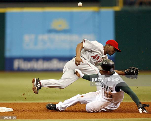Tampa Bay's Carl Crawford successfully steals second as Los Angeles Angels second baseman Howie Kendrick cannot handle the throw at Tropicana Field...