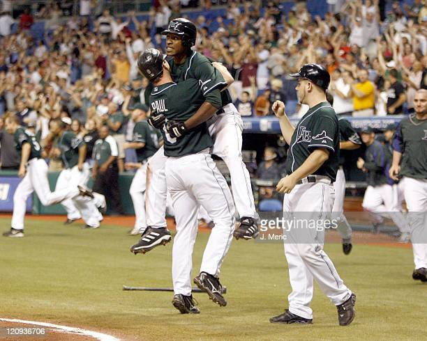 Tampa Bay's Josh Paul is congratulated by BJ Upton after Paul scored the winning run in Friday night's action against Seattle at Tropicana Field in...