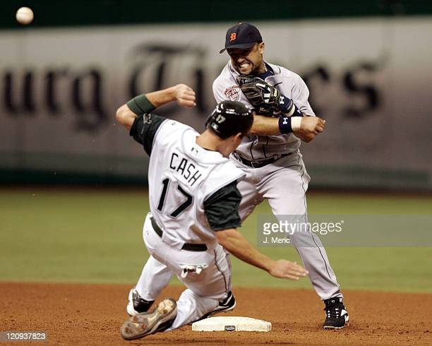 Tampa Bay's Kevin Cash tries to break up a double play as Detroit's Placido Polanco makes the throw to first in Sunday's game at Tropicana Field in...