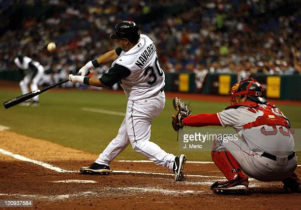 Tampa Bay's newly acquired catcher Dioner Navarro fouls off this pitch as Boston's Jason Varitek prepares to receive this pitch during Tuesday's game...