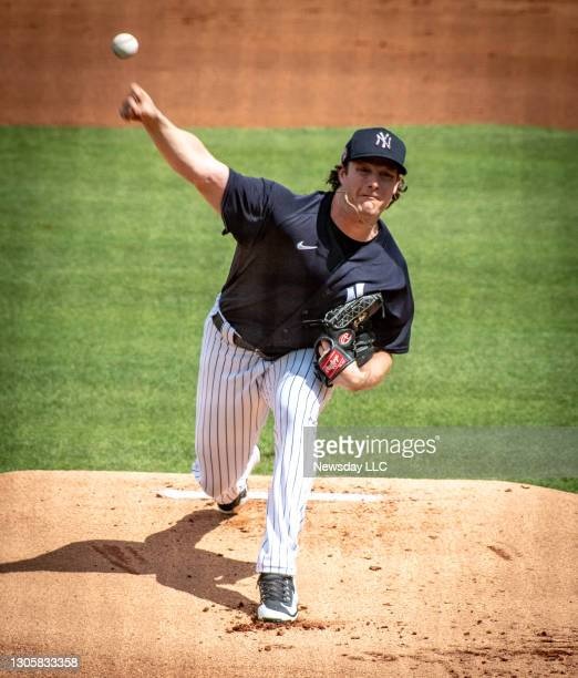 New York Yankees' pitcher Gerrit Cole pitching against the Detroit Tigers in the first inning during spring training at George Steinbrenner Field in...