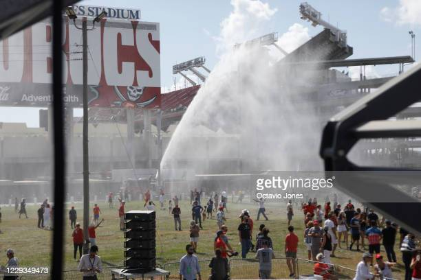 Tampa Fire Rescue sprays water to cool off supporters of President Donald Trump during his campaign speech just four days before Election Day outside...